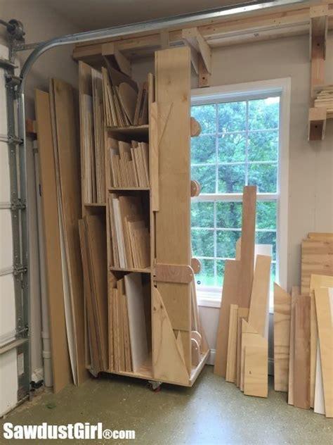 rolling lumber cart  vertical wood storage sawdust girl