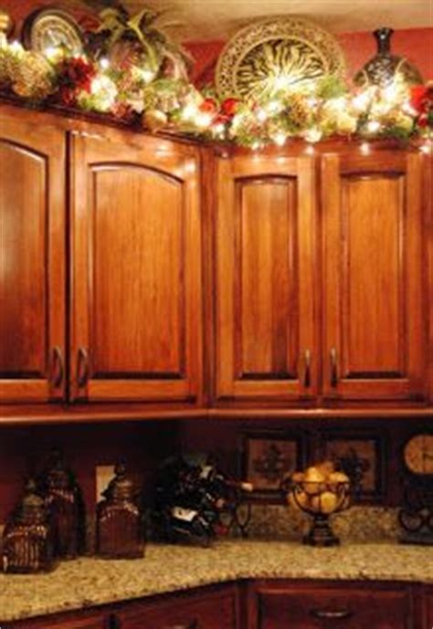 garland for above kitchen cabinets 1000 images about kitchen on decorating above 6791