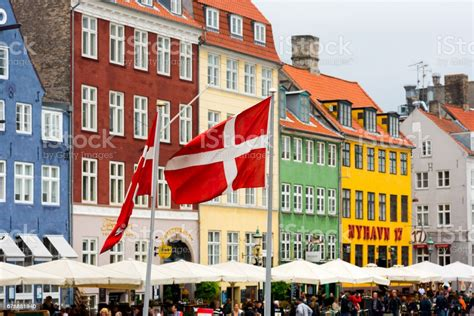 Flag of denmark describes about several regimes, republic, monarchy, fascist corporate state, and communist people with country information, codes, time zones, design, and symbolic meaning. Danish Flags Nyhavn Copenhagen Denmark Stock Photo ...