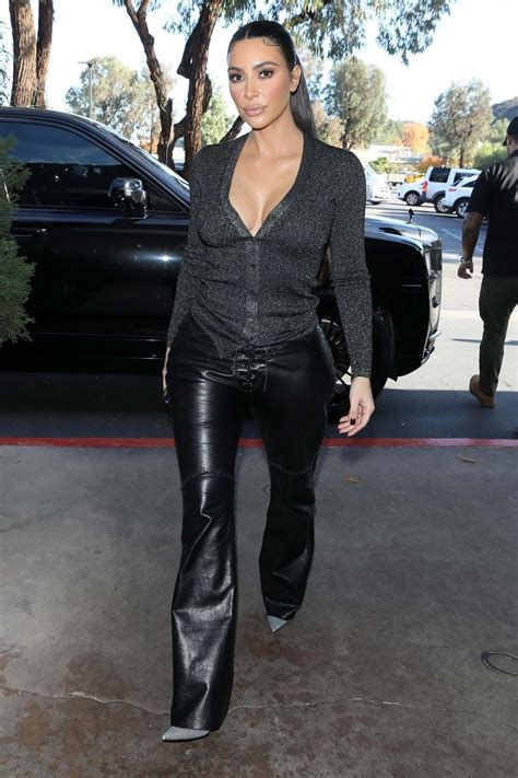 Kim Kardashian looks amazing in a plunging top and leather ...