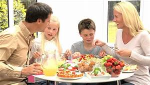 Young Caucasian Family Eating Healthy Lunch Together Stock ...