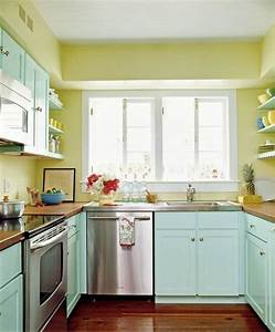 tiny kitchens with big impact With kitchen colors with white cabinets with teal and yellow wall art