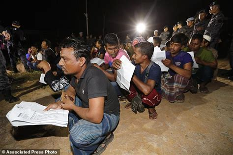 malaysia detains 77 foreigners in migrant worker crackdown daily mail