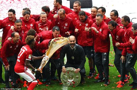 Pep Guardiola left completely drenched in beer during ...