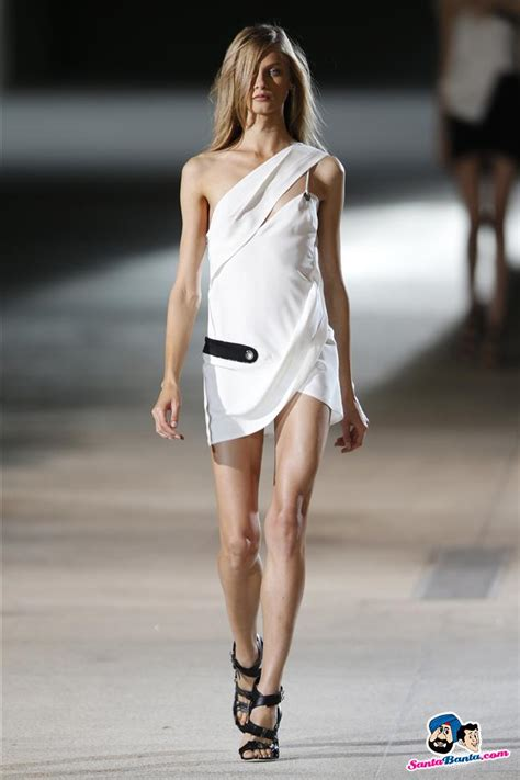 A model presents a creation by designer Vaccarello as part of his Spring-Summer Picture # 200045