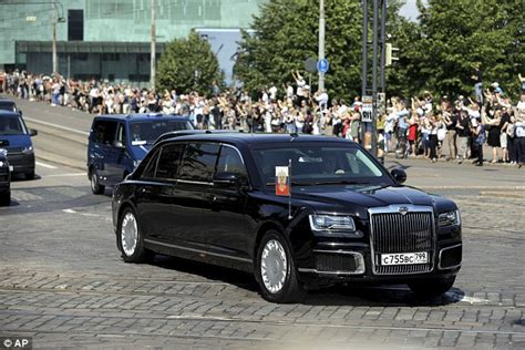 putin rolls into helsinki for his overseas use of his new kortezh limousine daily mail