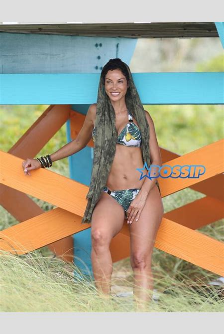 Nicole Murphy Poses For A Miami Beach Bikini Photoshoot: Nicole Murphy shows off her assets in a ...