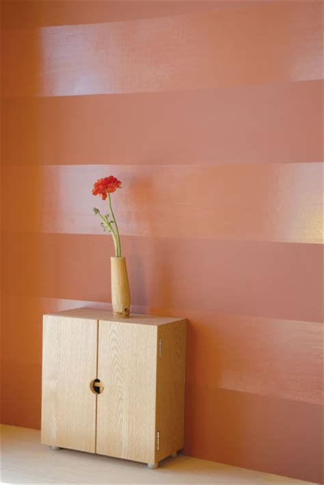 this alluring wall s glossy surface reflects light and