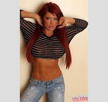 Busty Redhead Shows Under Boobs