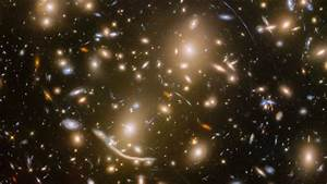 Countless galaxies billions of light-years away shine in ...