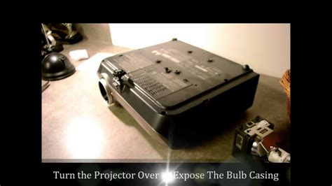 how to change a projector l or projector bulb