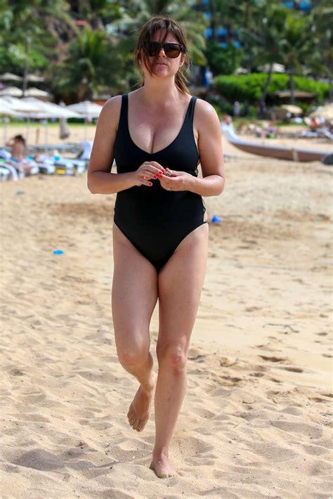 Tiffani Amber Thiessen in Black Swimsuit on the beach in Oahu   Celebs by lianxio