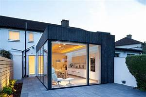 A Charred Wood And Glass Extension Was Designed For This