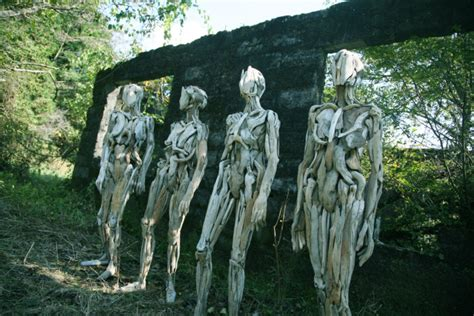 haunting driftwood forest spirits  japanese sculptor