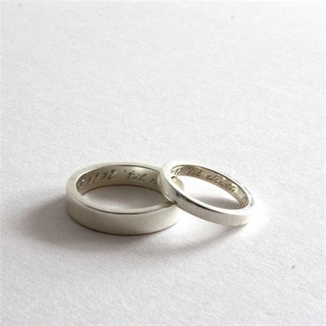 pair of rings personalised siver bands by rock cakes