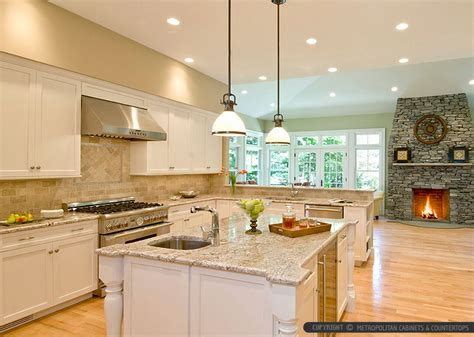 white cabinets with beige countertop bianco romano countertop travertine backsplash tile