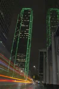 green lighting turned on dallas skyscraper