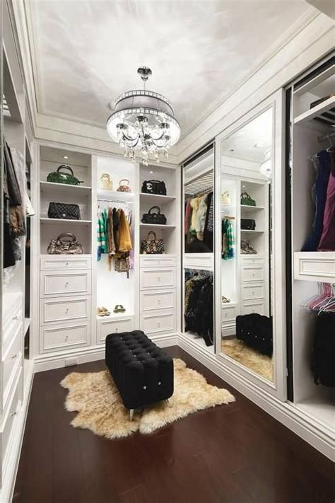 chic walk in closet features a droplets chandelier