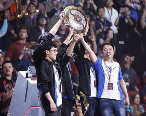 the wings gaming team after winning the international dota 2 chionships in seattle provided