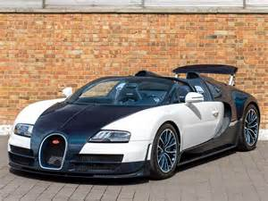 Drop the veyron's top, and at 255mph you'd have nothing left to worry about. 2014 Used Bugatti Veyron 16.4 Grand Sport Vitesse | Carrara White with Blue Carbon