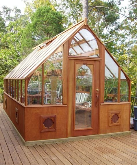 Slide the wall panels into the slots in the frame. Tudor Greenhouse Pictures - Sturdi-Built Greenhouses ...