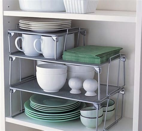 kitchen cabinet shelf risers install some cabinet shelf risers to maximize space 22