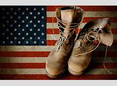 Army boots on sandy flag background Stock Photo Colourbox
