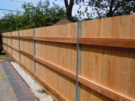 Steel Posts On Wooden Fence