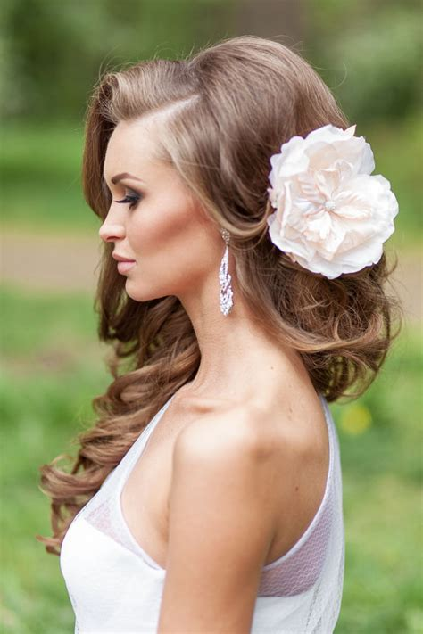 curly bridal hairstyle with blush flower   Deer Pearl Flowers