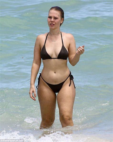 swimsuit designer bianca elouise flaunts  shapely
