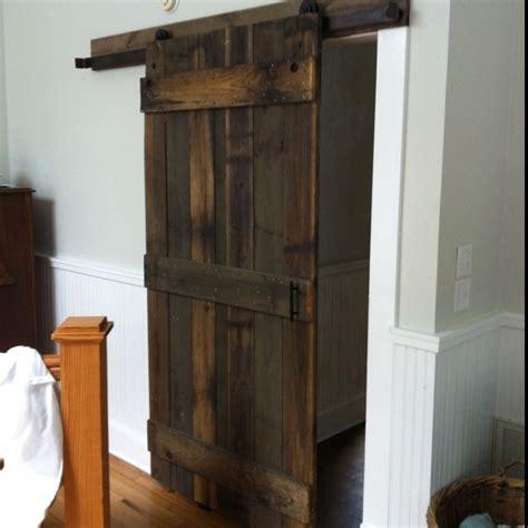 barn door leading to bathroom closets rehab