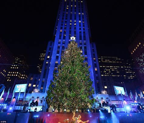 rockefeller center christmas lights turned on with help from mariah carey cee lo green and rod