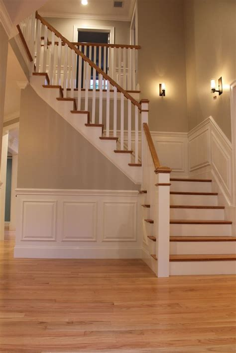 light oak staircase with hardwood in living room