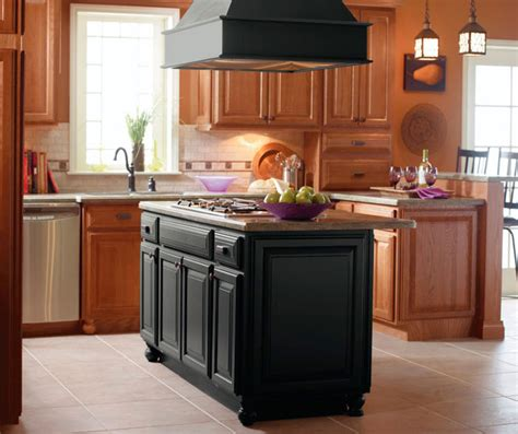 island kitchen cabinets light oak cabinets with black kitchen island kemper