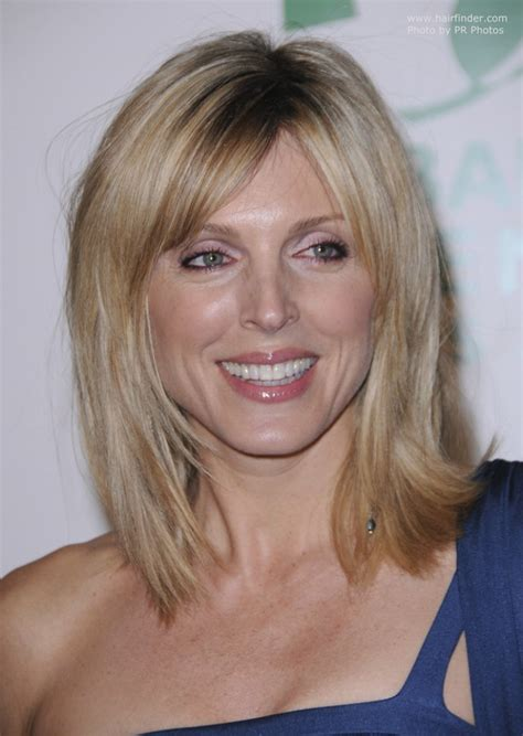 marla maples wearing  hair angled    shoulder