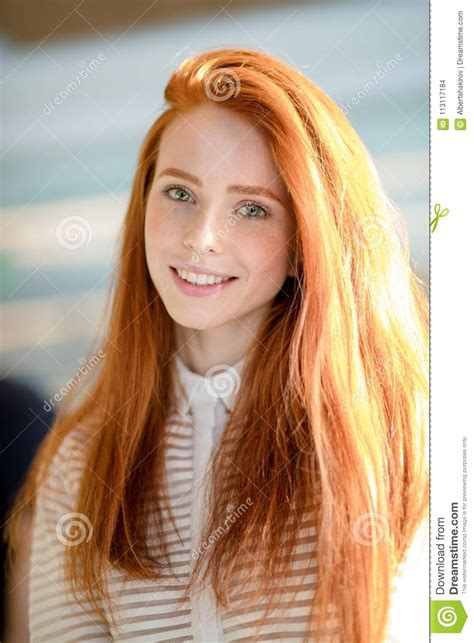 Ginger Female With Long Straight Shiny Hair And Natural