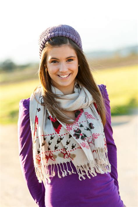 Portrait Of Cute Teen Girl With Scarf And Beanie Stock