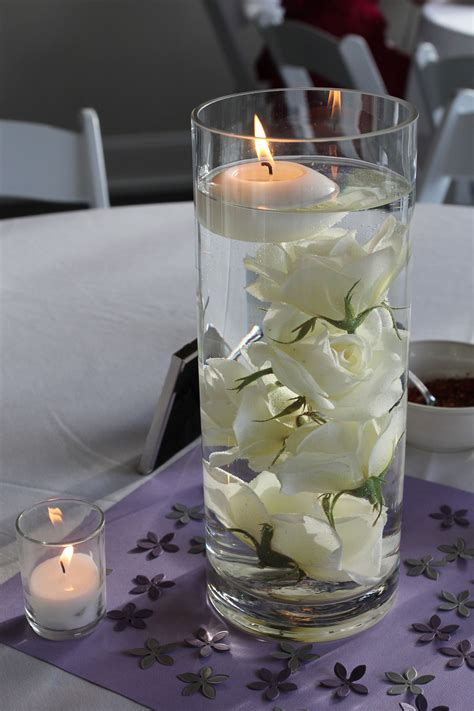 submerged rose centerpieces  floating candle
