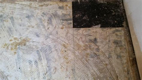 tile dealing  asbestos floor tiling home