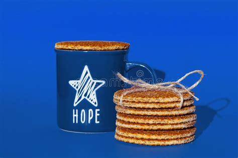 Dari luar, tampilan kafe 'brown fox waffle & coffee' tampak menarik. Dutch Waffle Stroopwafel Background Cookies Round Brown Pastries Blue Cup Coffee Tea Hope Star ...