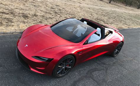 Tesls Car by Tesla Unveils Electric Sports Car As Semi Truck Makes