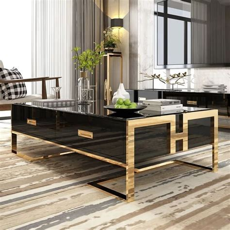 This round coffee table exudes a modern vibe that complements global eclectic to urban spaces. Jocise Contemporary White/Black Rectangular Storage Coffee ...