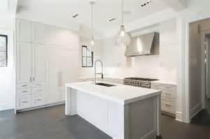 white kitchen with island white kitchen island with two seeded glass pendants transitional kitchen
