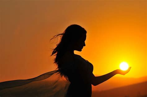 sunlight l for sad woman holding sun in palm of her hand motley news
