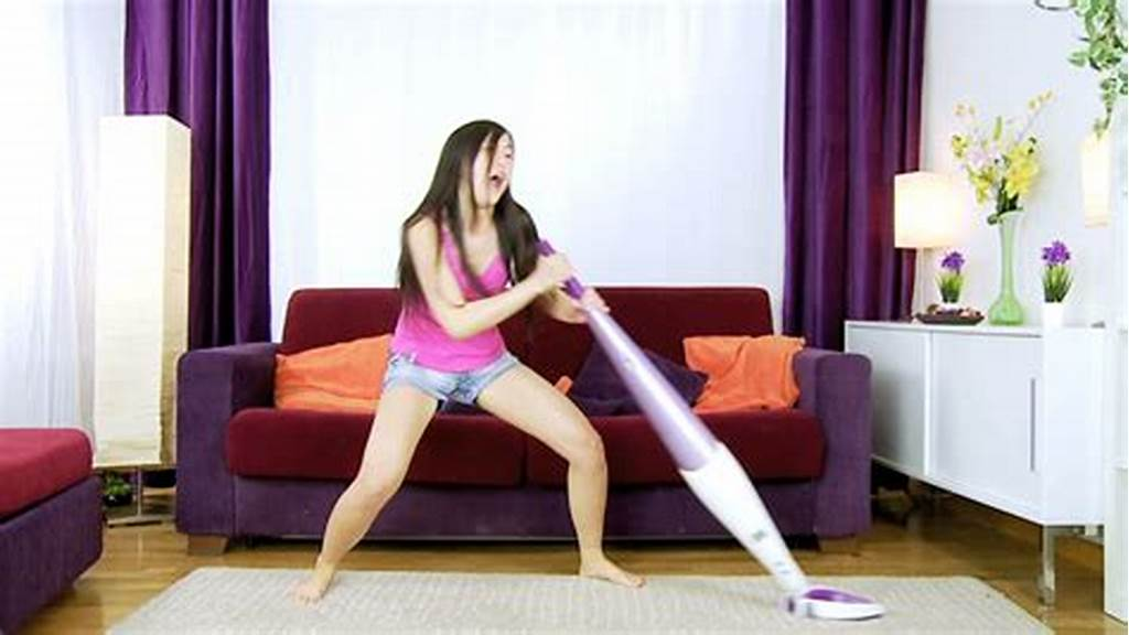 #Asian #Girl #Cleaning #Living #Room #With #Vacuum #Cleaner #Happy