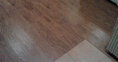 engineered or laminate how to eliminate the quot toe kicker quot when laminate or engineered flooring meets ceramic tile hometalk