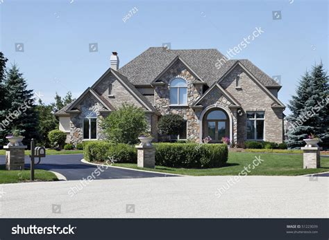 suburban brick home cedar roof stock photo 51223039