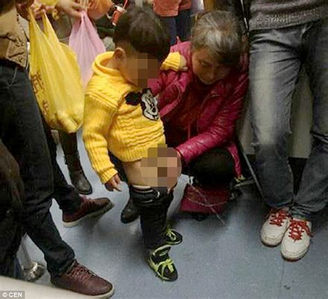 chinese woman lets  grandson urinate   shanghai