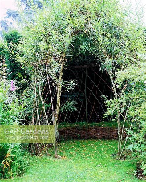 gap gardens living willow arbour  grass seat