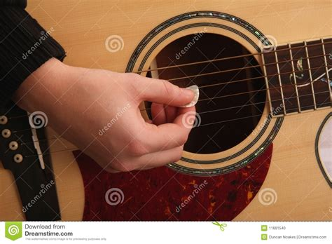guitar strumming stock photo image